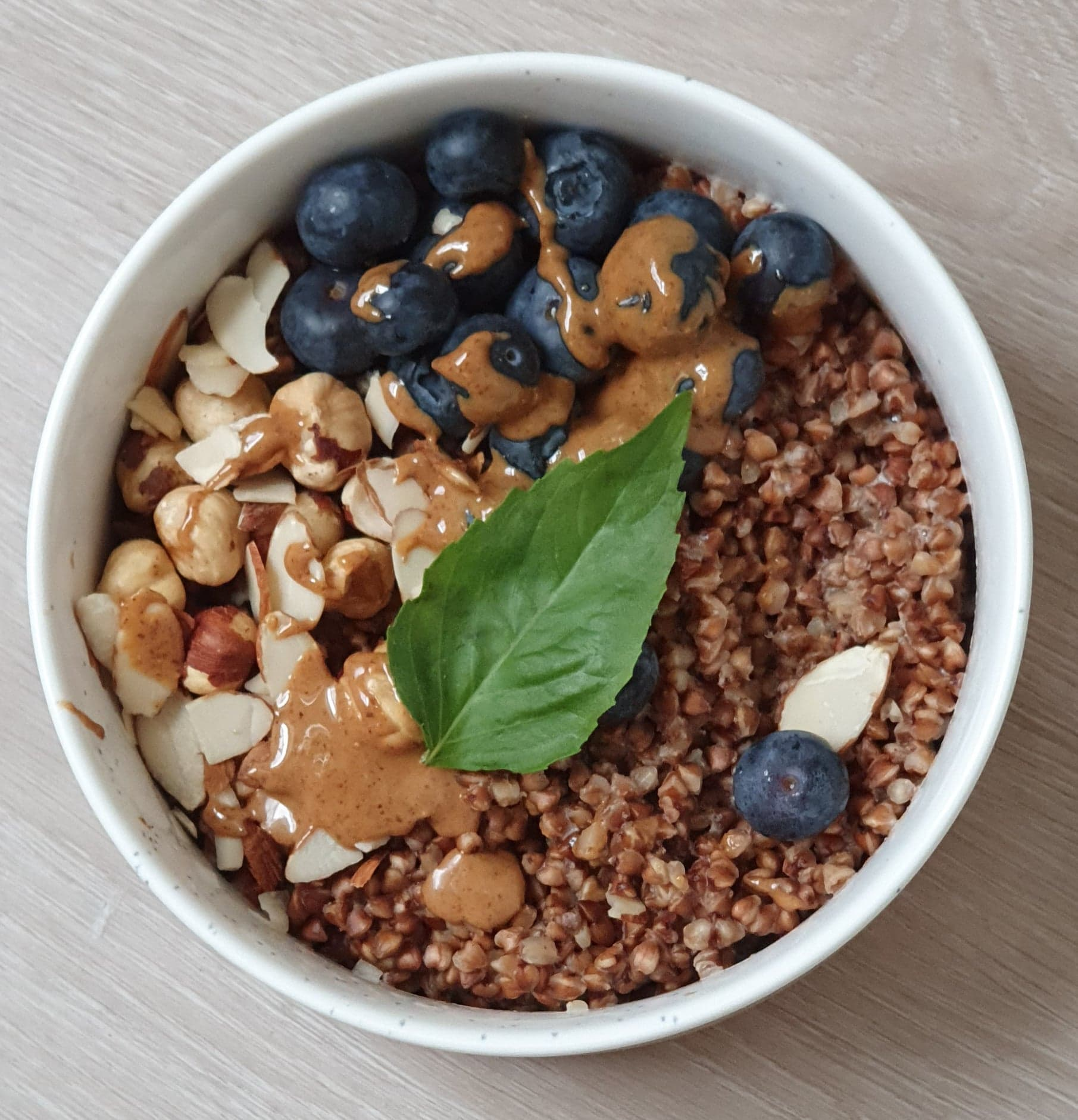 berry breakfast porridge with roasted buckwheat and nut butter